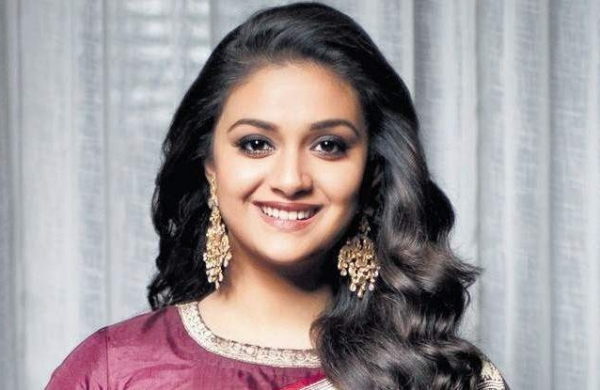 Keerthi Suresh in a close-up with a famous actor