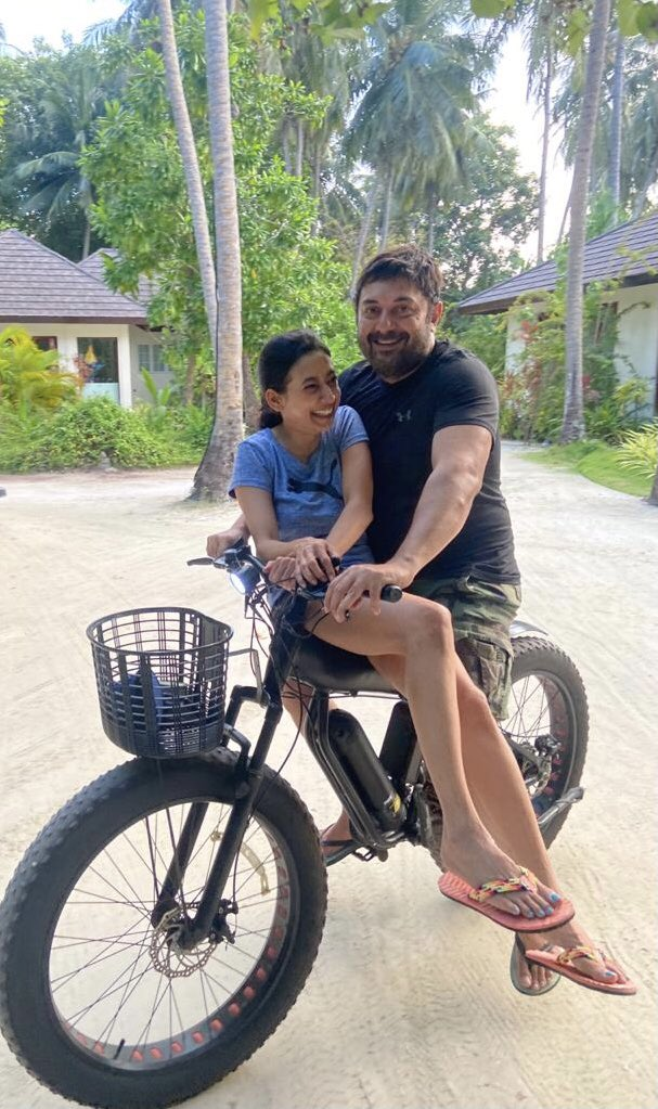 Arvind Swamy riding a bicycle with his daughter
