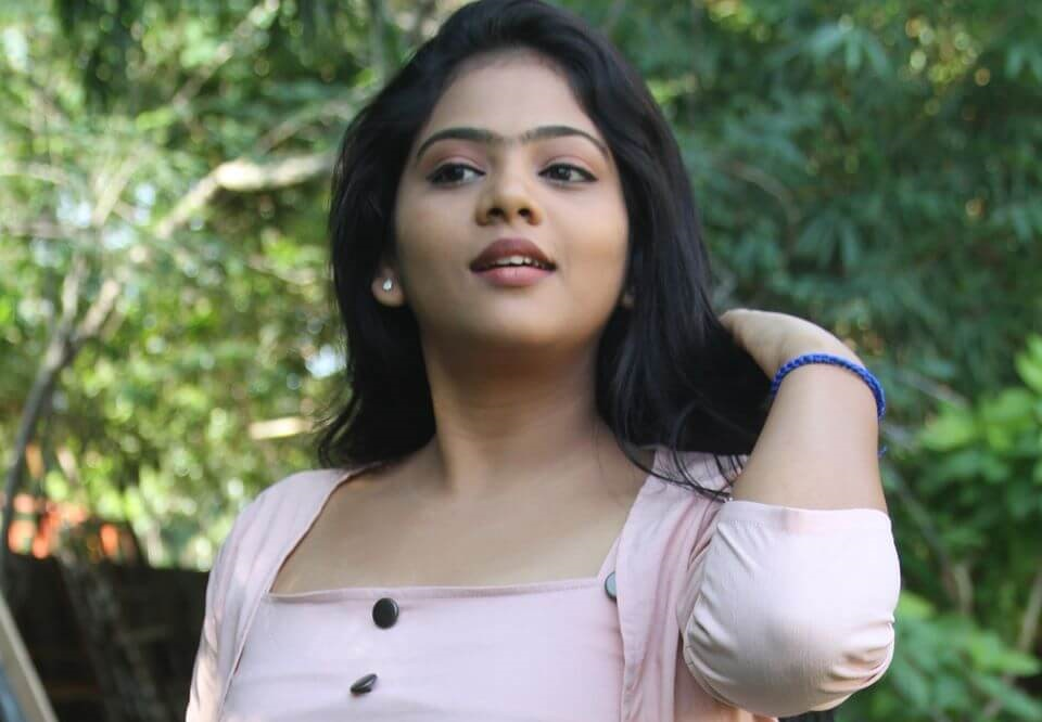 Actress Meghna Elan in the film with emphasis on the heroine