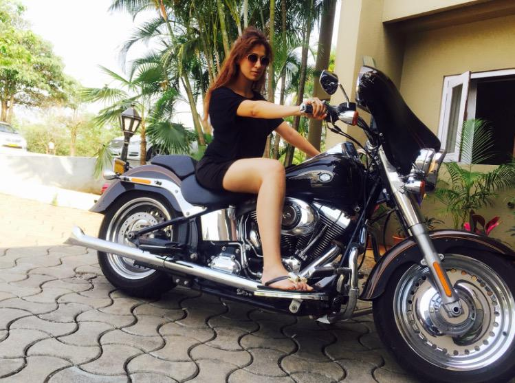 Ajith is a beautiful film actress rides a bike