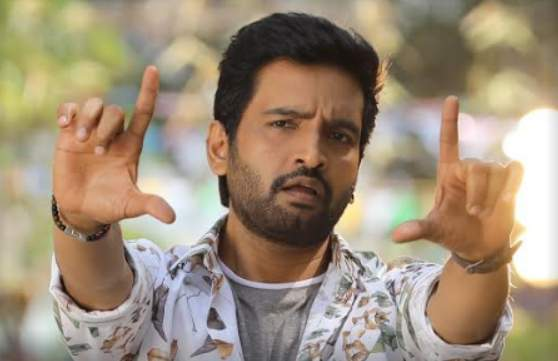 Santhanam has confirmed that he will compete with Vijay Sethupathi