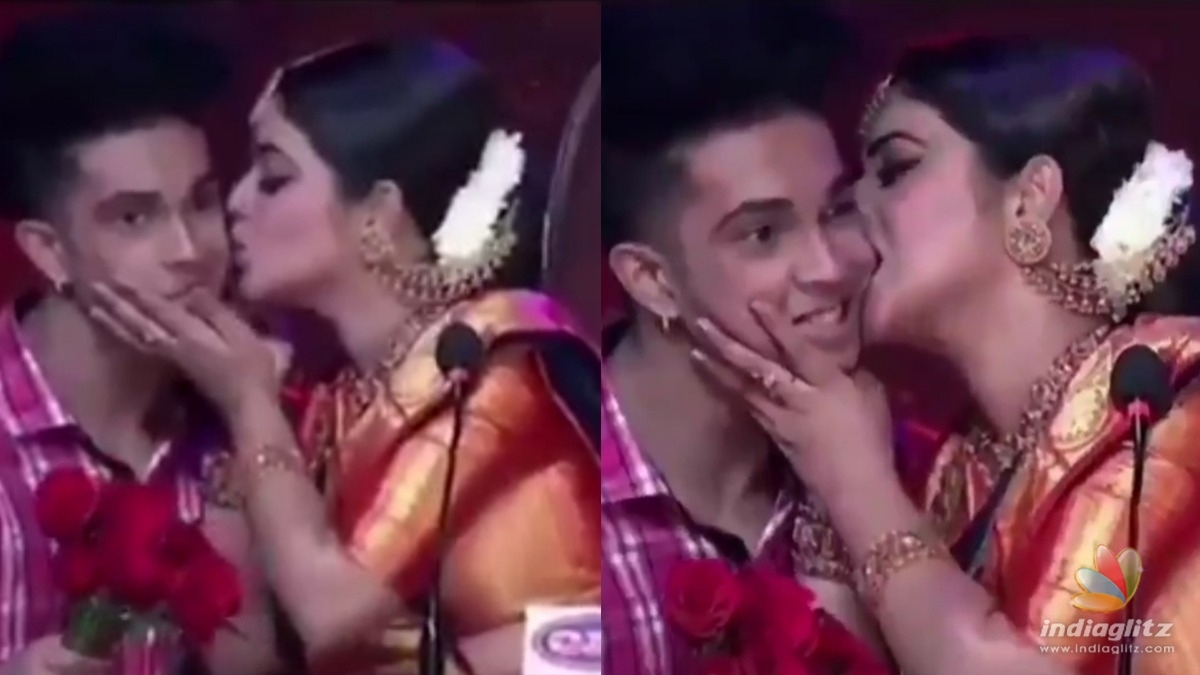 Actress Poorna kisses a contestant in TV dance show