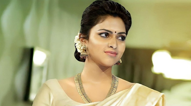 Amala Paul dancing with a bottle of wine in her hand